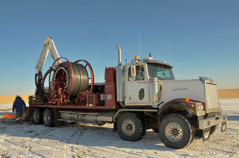 Coiled Tubing rig servicing a well near Kindersley, Saskatchewan.