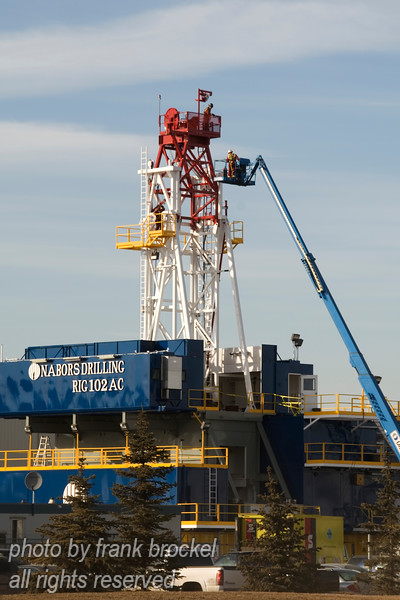 Workers doing maintenance on an oil rig