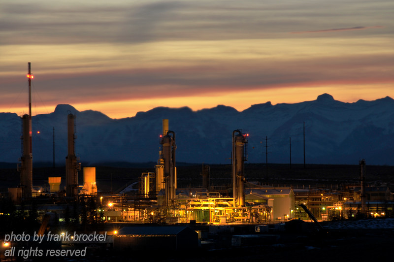 Petro-Chemical Complex near Cochrane, Alberta, Canada at sunset with the Rocky Mountains as backdrop
