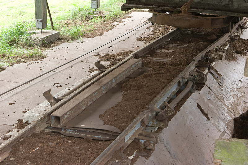 Detail of the car dumper. The hooks clamp the wheels to the rails and the entire track section is tilted to empty the car.