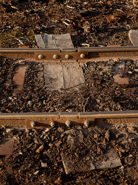 Rail joint. The sectional track with steel sleepers is laid directly onto the peat and apparently things didn't quite fit as intended.