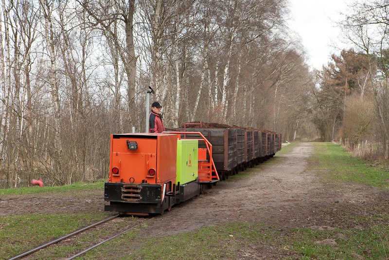 A trainload of peat is en route to the works, pushed by a very modern engine.