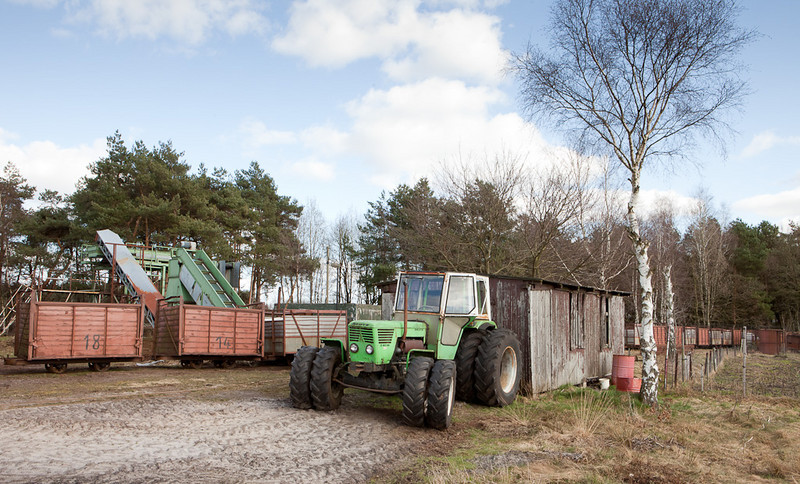 Bog tractor parked in front of the workshop.