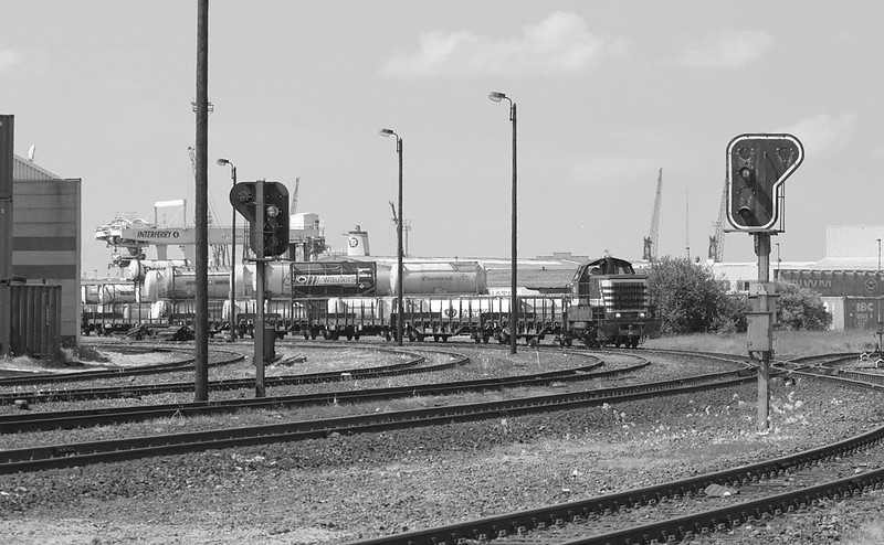 A 73-class switcher shifts cars in the Angola Yard, port of Antwerp.