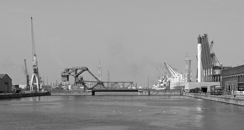 Wilmarsdonkbrug and cranes in the port of Antwerp.