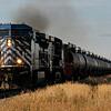 Train pulling tank cars