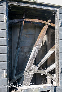 Waterwheel of the Wipmill De Kikkermolen Leiden Holland. The smallest windmill of the Netherlands