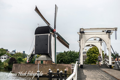 Windmill De Put, Leiden, Holland with the Rembrandt bridge.