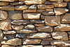 Granite rubble rock mortar ledge wall