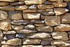 Granite rubble rock mortar ledge wall