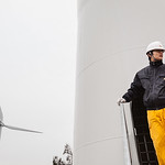 A China Resources New Energy Group Co., Ltd. employee stands on a wind turbine maintenance platform in Shantou, Guangdong Province, China on Friday, Jan. 21, 2011. Photographer: Forbes Conra ...