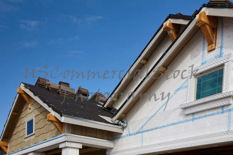 Home building industry gable roof slope transition and stucco roof prep