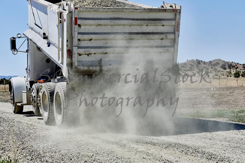 Dump Truck spreading Gravel on Driveway