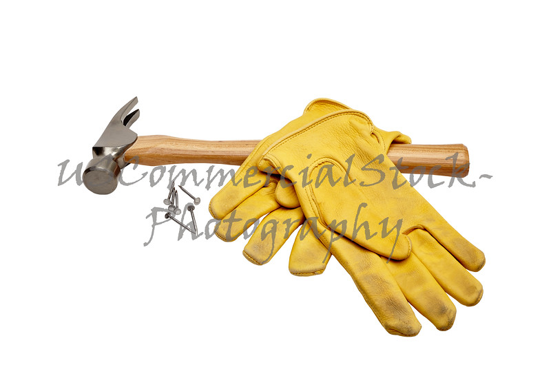 Hammer, nails and work gloves isolated on white
