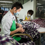 Workers process shirts at the Lever Style Inc. Guan Lan Town production facility for Shirts and Blouses in Shenzhen, Guangdong Province, China on Wednesday, Dec. 8, 2010. Photographer: Forbe ...
