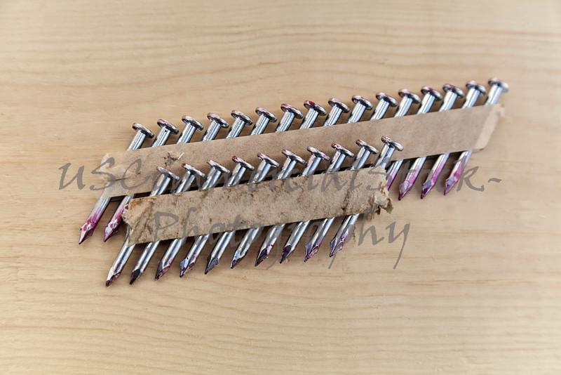 Used Strip of Air Gun Nails