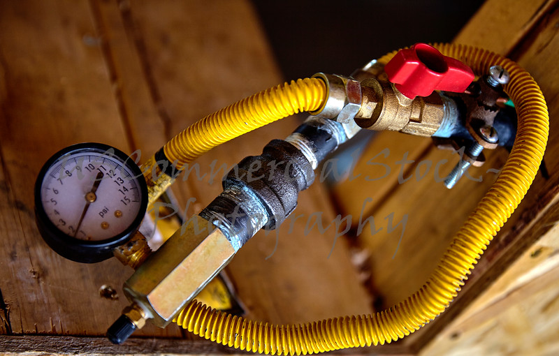 Construction building industry residential home gas valve and gauge closeup