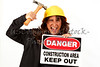 Woman hitting Hard Hat with Hammer