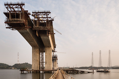A bridge crossing the Pearl River (珠江) near the Huangpu Ancient Port (古港景点步行街) is under construction in Haizhu District, Guangzhou, Guangdong Province, China.