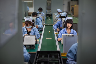 Workers assemble power supply components at the ICCNexergy factory campus in QingXi, Dongguan, Guangdong Province, China.