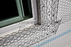 Home building industry house window sill stucco mesh installation closeup