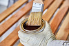 Varnishing a Wood Slat with a Paint Brush
