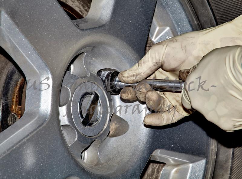Mechanic Removing Lug Nut