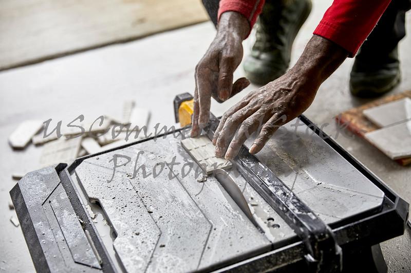 Man cutting Ceramic Tile