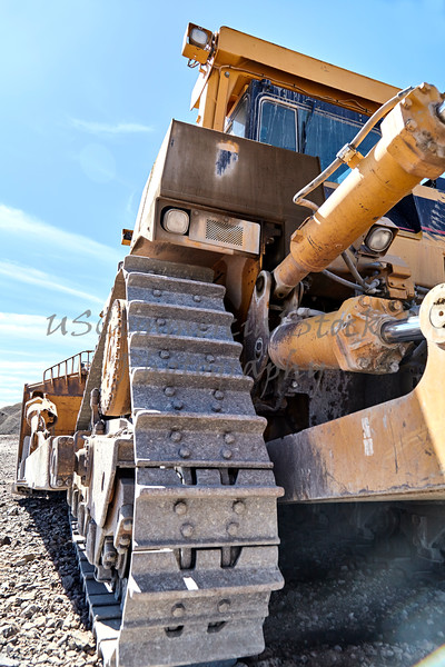 Construction heavy equipment bulldozer grading jobsite gravel fill
