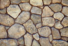 Rubble rock stone mortar wall closeup