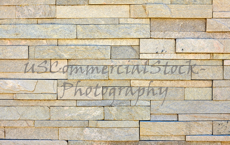 Stone veneer white mineralized granite rock wall