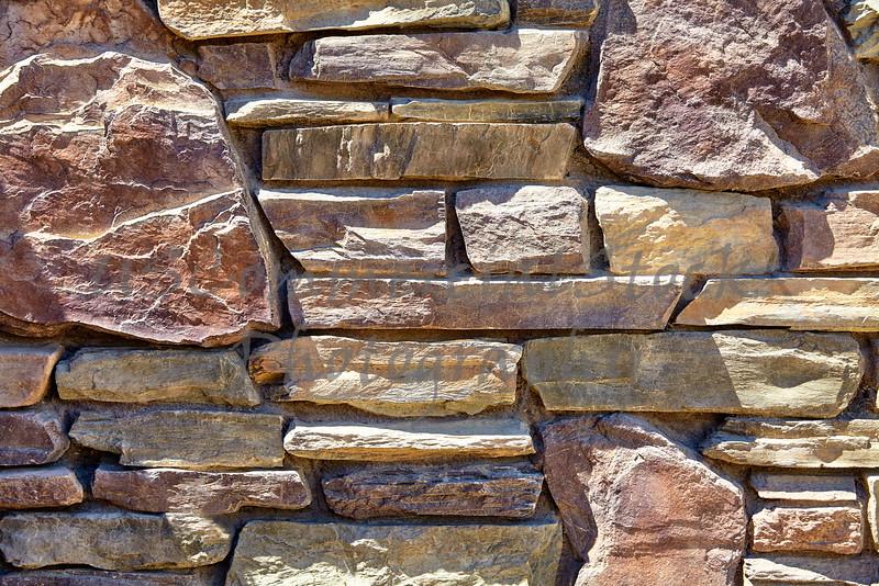 Rustic ledge rubble rock decorative wall closeup