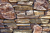 Rustic ledge rubble rock decorative wall closeup