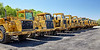 Heavy equipment tractor scrapers