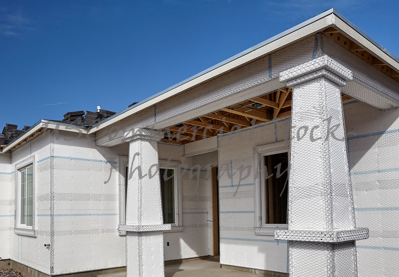 Home building industry house wall and entry ready for stucco