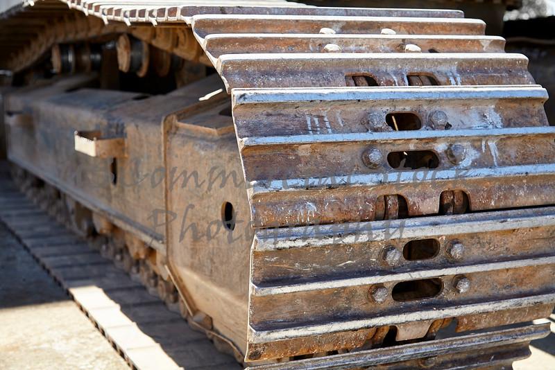 Heavy equipment excavator tracks closeup