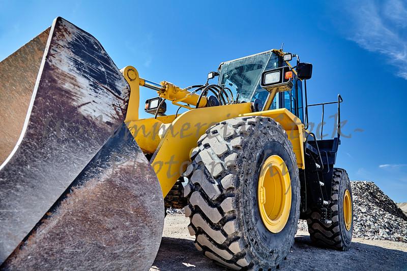 Heavy equipment machine wheel loader on construction jobsite