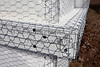 Home building industry house post ledger stucco mesh closeup