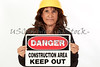 Woman holding a Danger Sign
