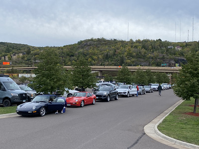 Porsche club members lining up for a drive from Duluth harbor two Grand Rapids, during peak fall color.