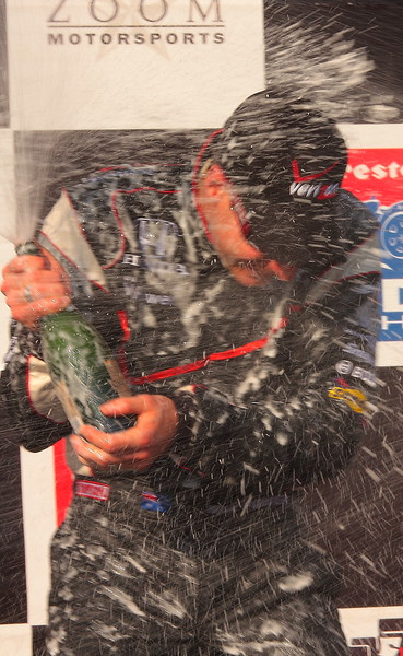 Will Power Blasted with Champagne on Podium after Winning Honda Indy Grand Prix of Alabama