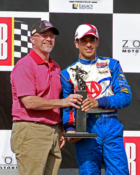 IndyCar Driver Helio Castroneves on Podium Barber with 3rd Place Finish