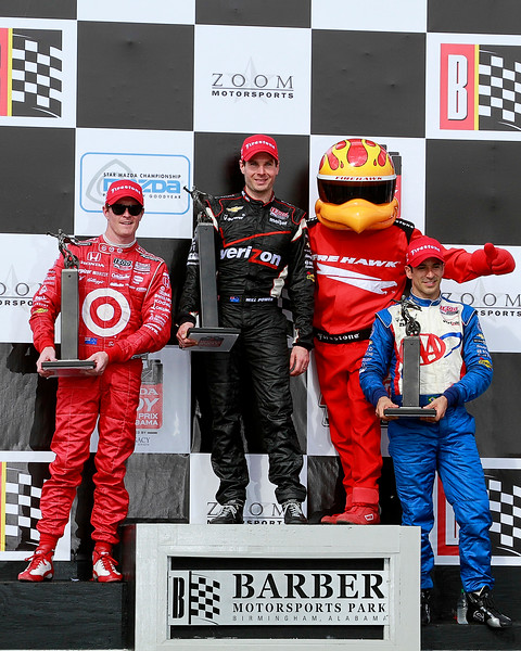 IndyCar drivers Will Power, Scot Dixon, and Helio Castroneves on the Podium after the Honda Indy Grand Prix of Alabama