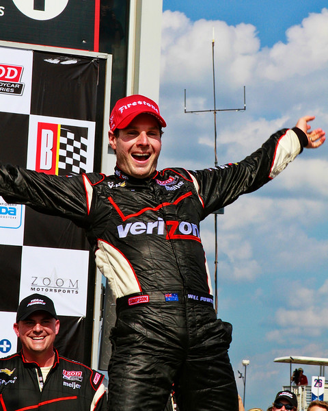 IndyCar's Will Power Leaps from his Verizon No. 12 Penske Race Car