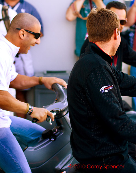 Izod Indycar Series drivers Tony Kanaan, Will Power, and Helio Castroneves goofing off before Indy Grand Prix of Alabama at Barber Motorsports Park
