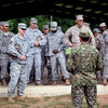 (FORT BENNING, Ga) Command Sgt. Maj. James J. Carabello reinstates the Foreign Wing Exchange program during a jump with El Salvador Capt. Jose Molina, August 19, 2013 at Fort Benning. The purpose of the Foreign Wing Exchange is to foster relations and build rapport between U.S. and Salvadoran Airborne communities. (Photo by Patrick A. Albright/MCoE PAO Photographer)