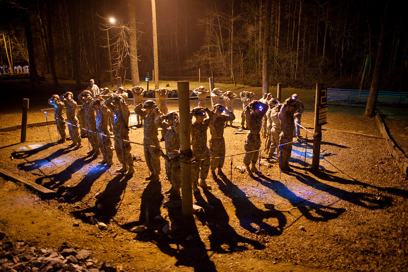 21 FEB 2011 - Ranger Training Class 4-11 completes a knots test early on day two of the Mountain Phase and moves immediately to rope bridge training and vertical haul line exercises.  Camp Merrill, Dahlonega, GA.  Photo by John D. Helms - john.d.helms@us.army.mil