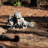 (FORT BENNING, Ga.) Spc. David Gray, 3rd Infantry Division, 1st Battalion, 15th Infantry Regiment, Alpha Company, high crawls to get into position during a practice run of the Patrol Lane of the Expert Infantry Badge training, Wednesday, April 13, 2013 at Selby Mout Site. EIB testing takes place over a five day period. (Photo by Ashley Cross: MCoE PAO Photographer)