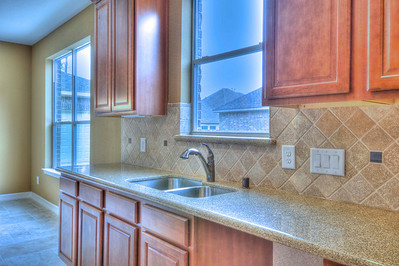 Granite Tops Raised Maple Cabinets