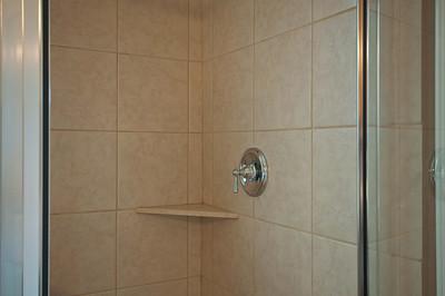 21. Tiled Shower with Shelves